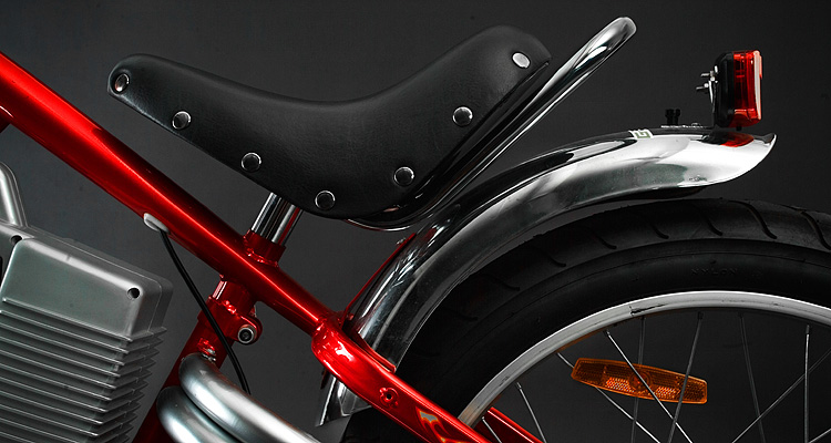 Seat detail of red electric chopper bike