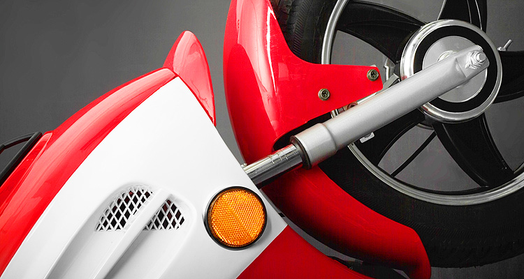 Detailed close ups of red electric bike