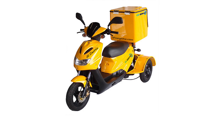 Angle shot of yellow commercial delivery trike