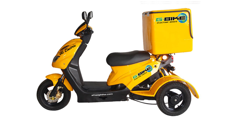Side shot of yellow commercial delivery trike